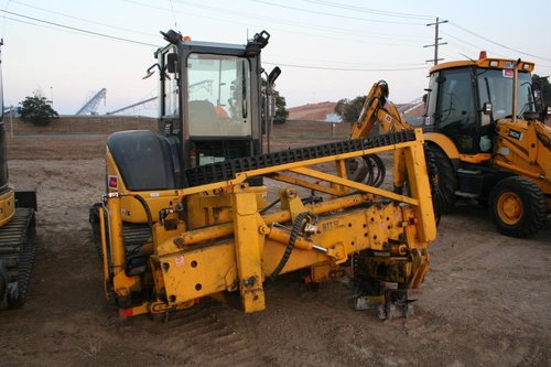Excavator with a sleeper insertion attachment fitted