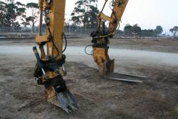 Excavators with grabbing and poking attachments