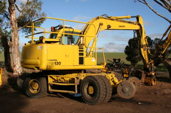 Komatsu PW130 with rubber tyres and hi-rail wheels