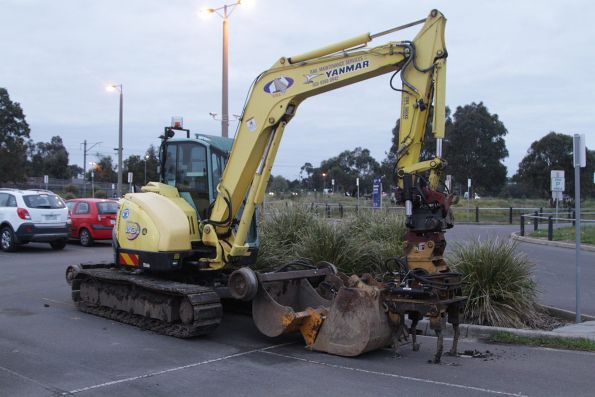 Hi-rail excavator with tamper attachment parked in the car park at Merinda Park station