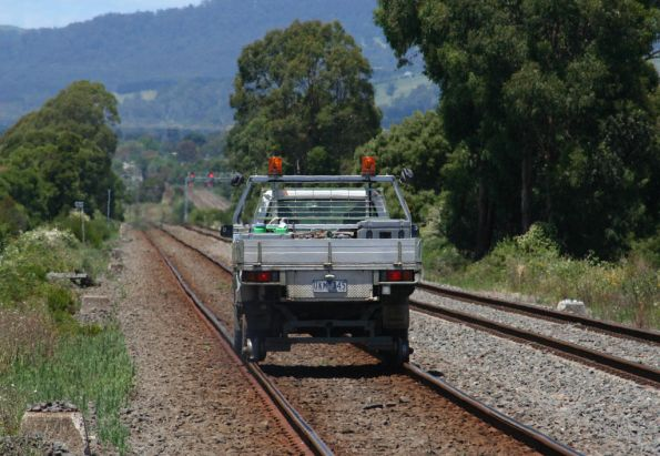 Hi Rail on the down doing level crossing testing heads for Yarragon