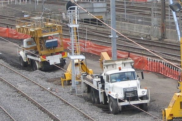 Rather old hi-rail trucks setup for working on the overhead