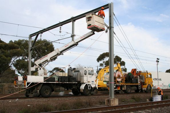 Pair of RFW hi-rail trucks at Laverton: one with a reel of cable, the other with a cherry picker