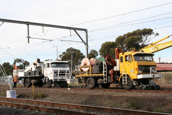 Pair of RFW hi-rail trucks working on the overhead lines at Laverton