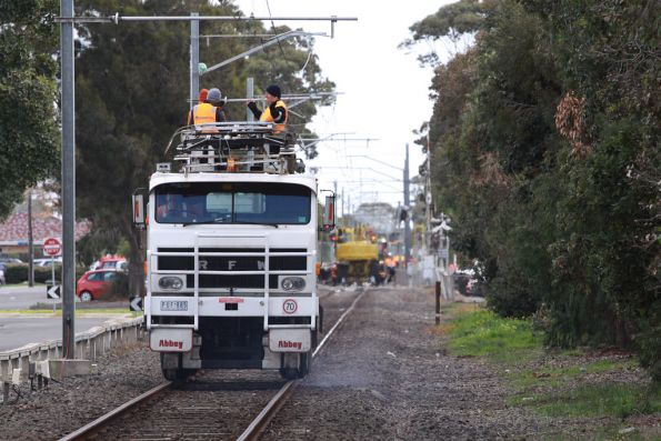 RFW all-wheel-drive overhead line maintenance truck, outside Altona station during an occupation