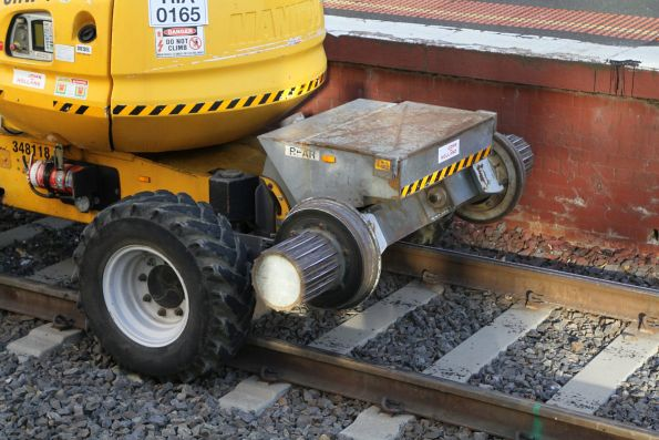 'Rear' wheels of a hi-rail fitted boom lift with type 9B 'high-ride' friction drive onto a friction hub fixed to the rail wheels