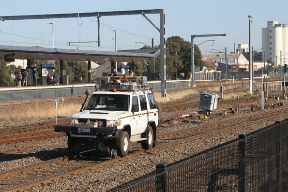 Speno crew follow the ultrasonic rail flaw detector in a hi-rail 4WD along the standard gauge at West Footscray