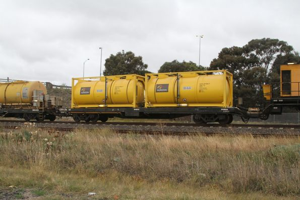 Ex-CFCLA CQFY container wagons loaded with a pair of tanktainers for diesel fuel