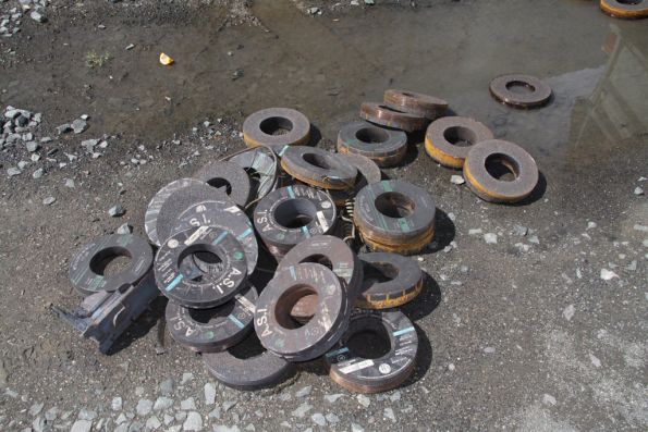 Large pile of worn out grinding wheels