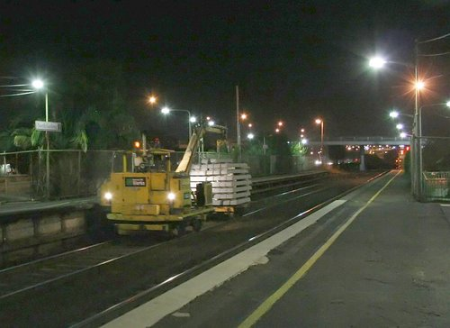 Loaded sleeper handling machine headed to the worksite from North Geelong towards Geelong