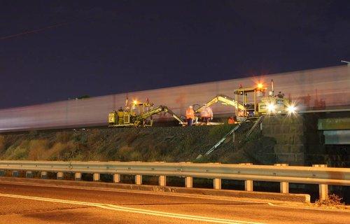 Standard Gauge freight runs past track work at Cowies Creek
