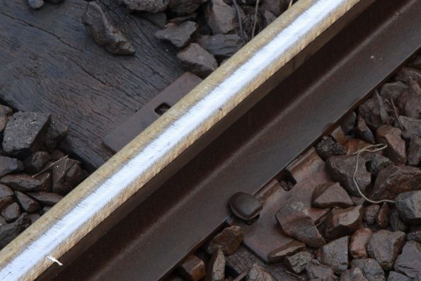Rails recently worked over by the rail grinder, note the various marks on the rail head