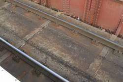 Rails bolted to the concrete deck of the Racecourse Road bridge at Newmarket