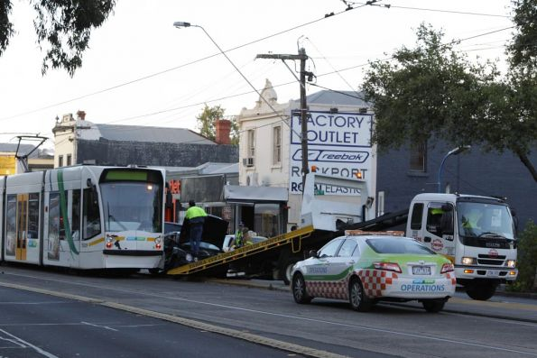 Yarra Trams operations crew in attendance, along with a tow truck, the MFB and Victoria Police