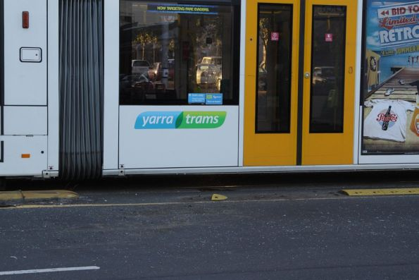 Missing rubber strips alongside the tram lane, probably ripped up when the car get hit by the tram