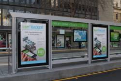TramTracker advertisements at the Collins and William Street tram stop