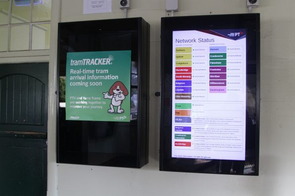 Yet to be commissioned TramTracker screen at Malvern station, beside a PTV network status board