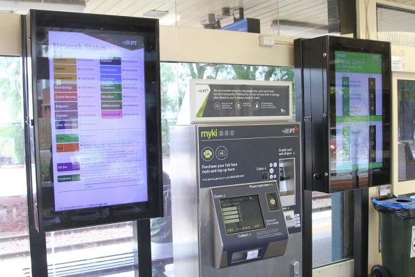 PTV status board beside the TramTracker screen for route 67 at Glenhuntly station