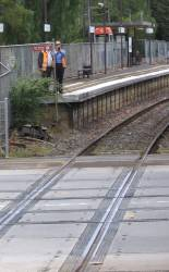 Connex staff at the Kooyong Station rail - road - tram level crossing with a radar gun