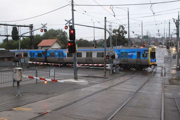 Comeng 534M passes through the tram square at Gardiner on the down