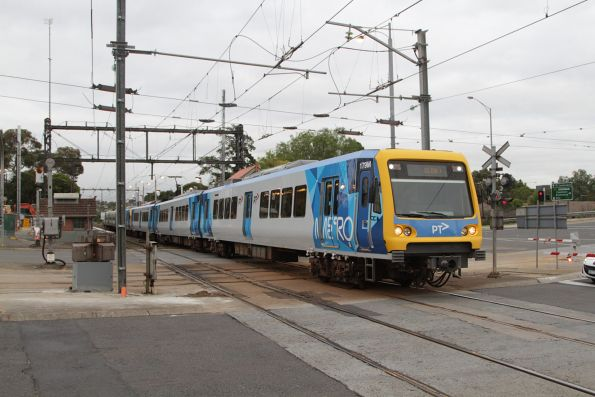 X'Trapolis 179M on a down Glen Waverley service crosses the tram square at Gardiner station