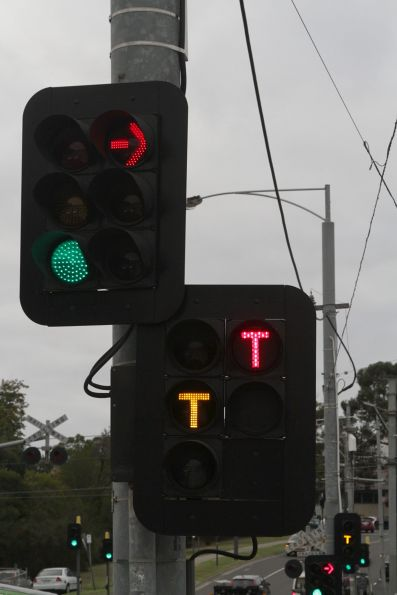 Yellow 'T' is from the traffic light controller, while the red 'T' is from the signal box at Gardiner