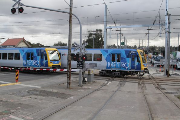 X'Trapolis 40M and 874M cross paths at the Gardiner tram square