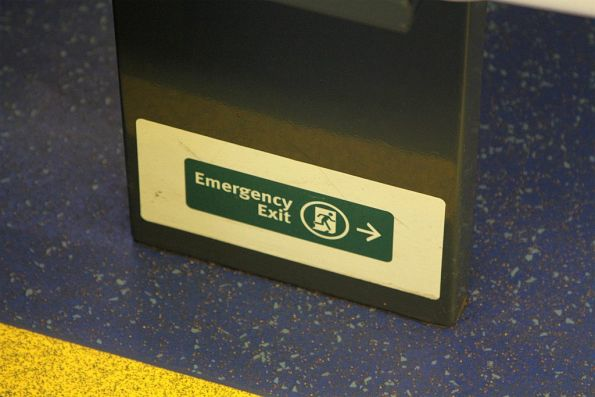 Emergency exit sign at the bottom of the seat frame onboard an A-City train