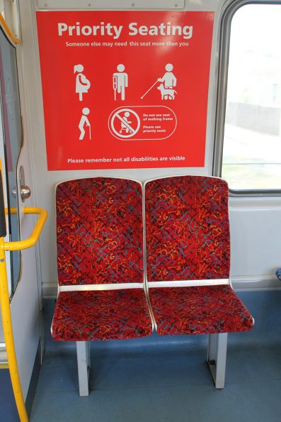 Red coloured priority seats onboard a 3000 class railcar