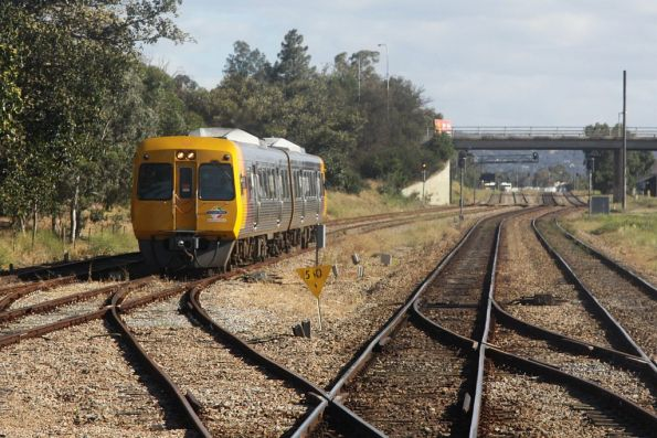 Passing Comeng 3135 and classmate at Mile End, the Gaol Loop crossovers in the foregrou