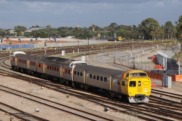 Jumbo 2118 in Adelaide Metro livery leads two classmates still in STA orange