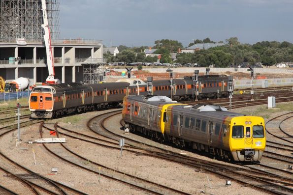 Adelaide's two remaining railcar liveries: STA orange on the left, and Adelaide Metro yellow to the right