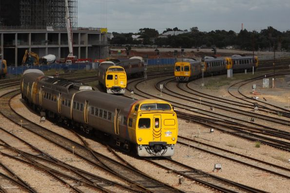 Triple arrival into Adelaide station: two Jumbos, and a Comeng in the shadows