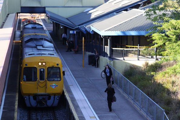 Comeng 3016 and classmate wait on peak hour commuters at Noarlunga Centre
