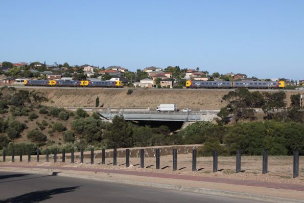 Trains pass at Hallett Cove: a 3-car set of 3000 class heads into town, as a pair of 3100 class head for Noarlunga