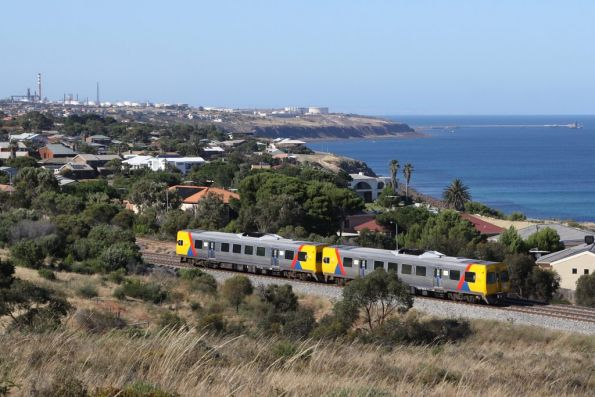 Looking across to the Port Stanvac refinery from Hallet Cove, as a pair of 3000 class head for Noarlunga