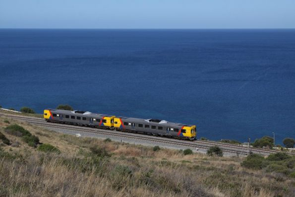Pair of 3000 class roll alongside the water, bound for the city at