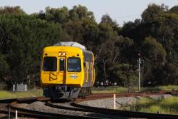A solo Comeng 3015 on the up at Torrens Junction