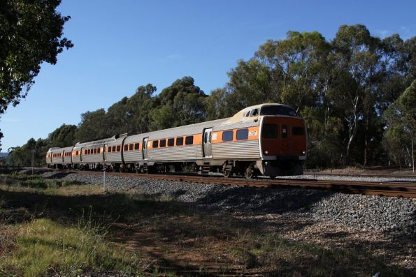 Jumbo 2107 leads a 3-car set in STA livery at Torrens Junction