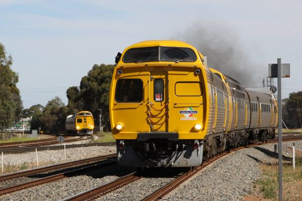 Pair of Jumbos on a parallel run into town at Torrens Junction