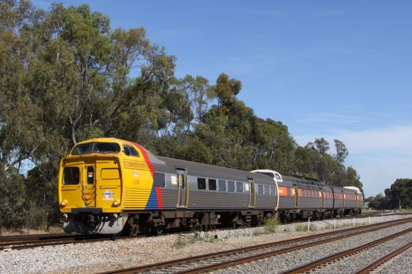 Jumbo 2118 leads a mixed liveried set on the up at Torrens Junction