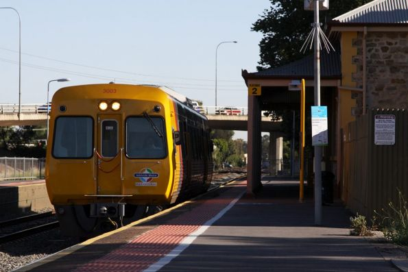 A solo Comeng 3003 heads into town at North Adelaide