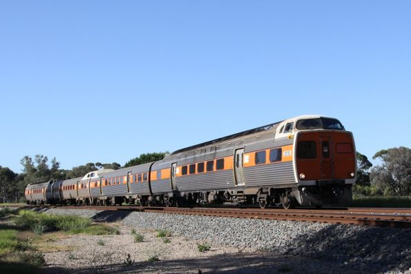 Four car Jumbo set led by 2010 heads towards Gawler at North Adelaide