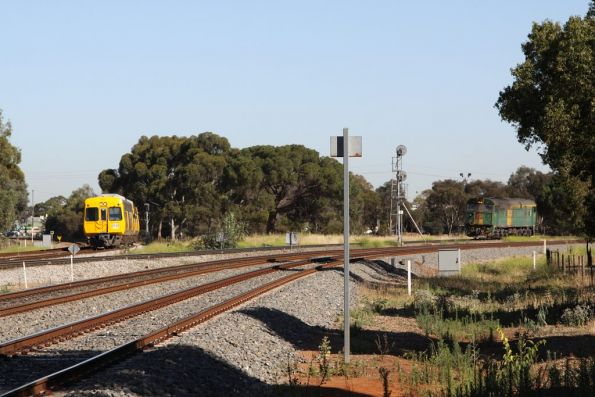 3000 class heads into town at Torrens Junction, holding up GWA's 701 at the grade crossing