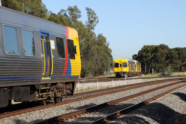 Up and down 3000 class cross paths at Torrens Junction