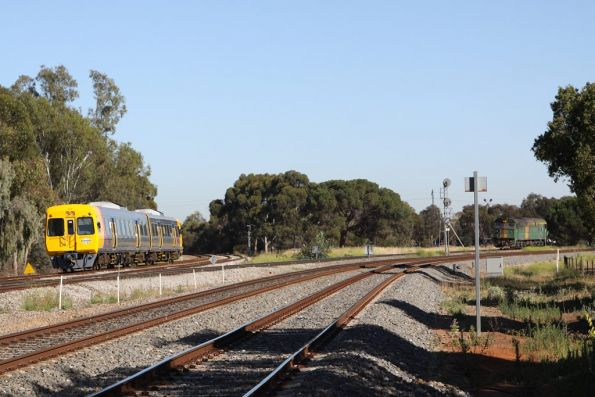 3100 class set heads to Outer Harbor as GWA's 701 waits for a path across Torrens Junction