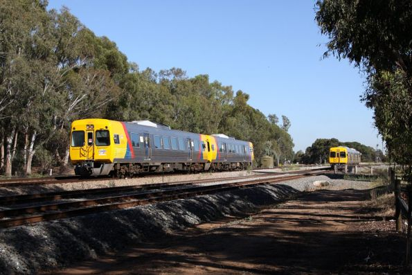 Pair of 3100 class sets from Outer Harbor and Gawler parallel each other at Torrens Junction