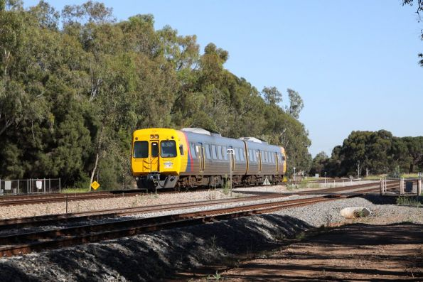 3100 class set rolling through a 5 track unprotected crossing at Torrens Junction: good thing the max speed is 65 km/h!
