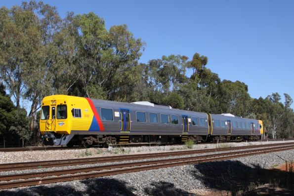 Comeng 3130 and classmate head into town at Torrens Junction