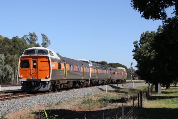 Jumbo 2110 in STA livery leads a 3-car set at Torrens Junction
